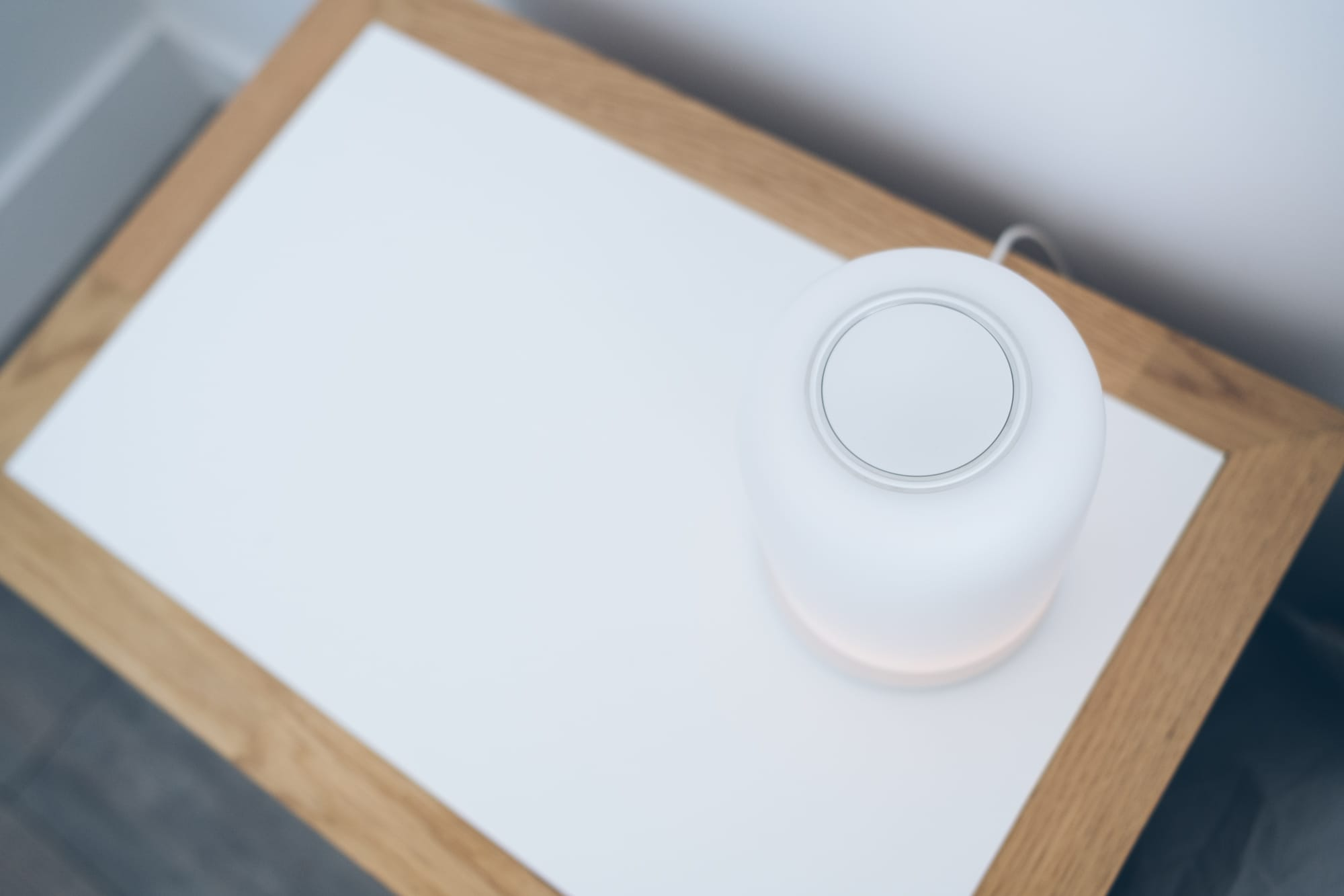 top viiew of lamp showcasing the big round button at the top