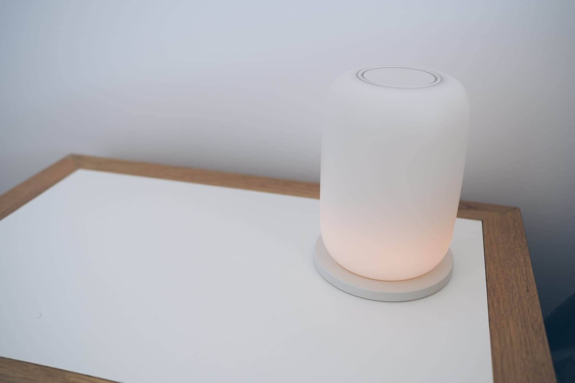 lamp on base with a slight glow coming from the bottom