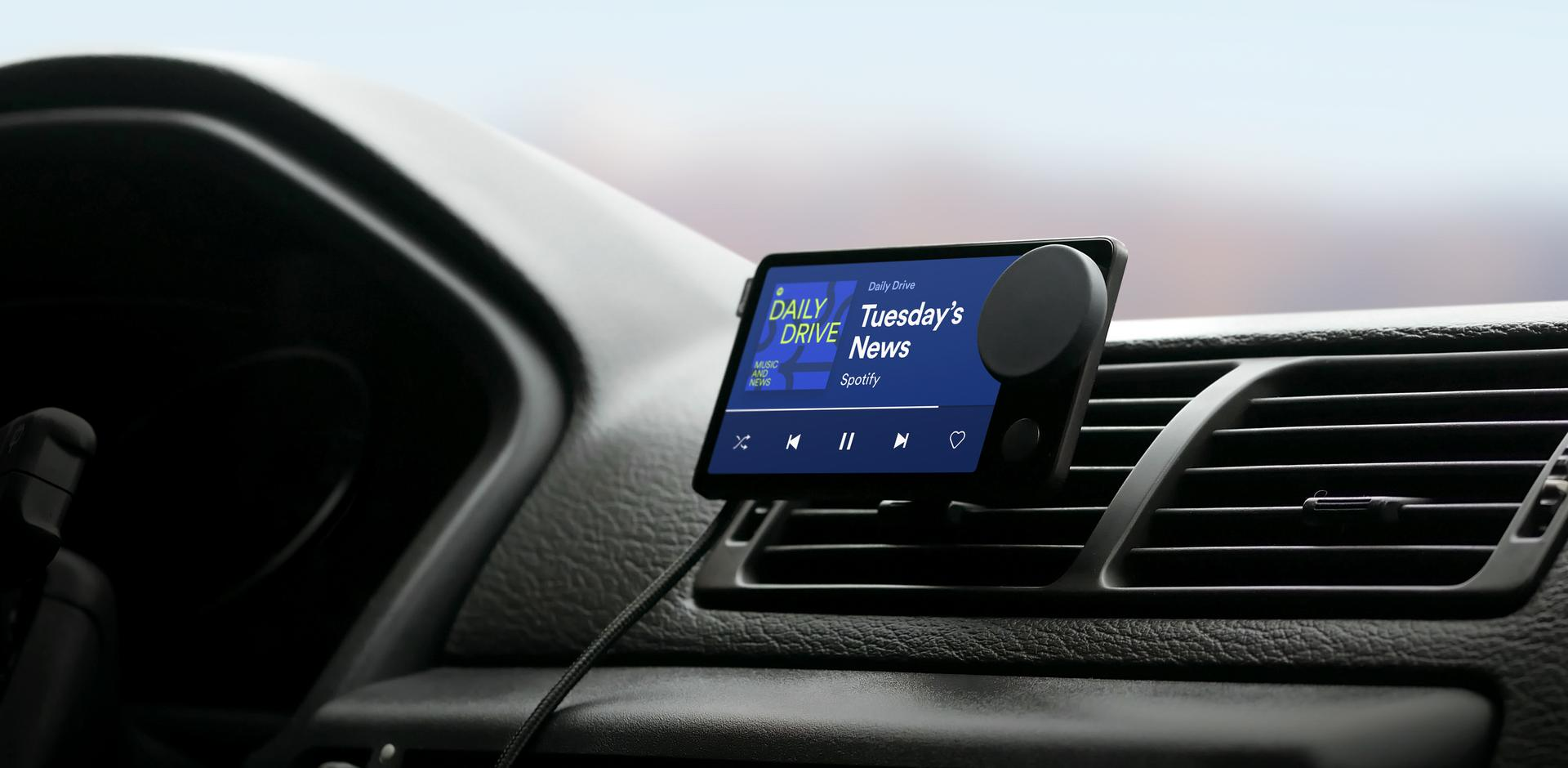 car thing attached to car vent playing a podcast
