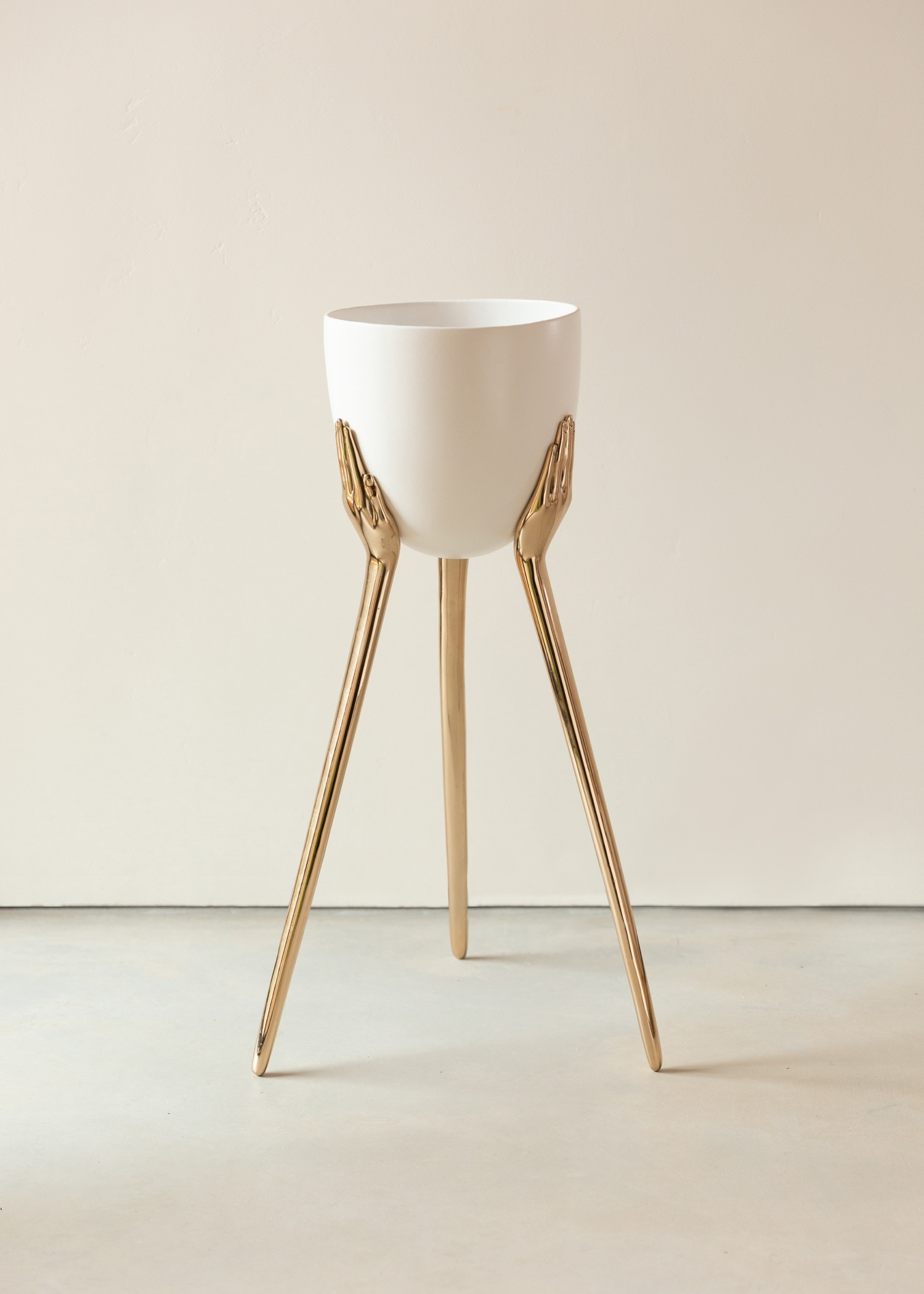 planter with brass hand base