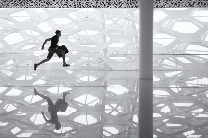 a man running with his luggage