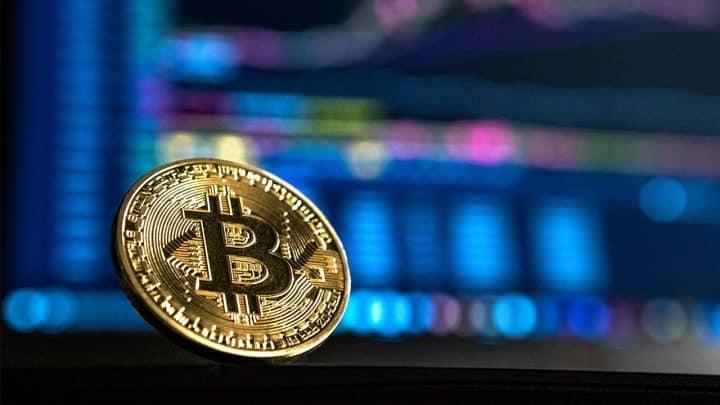 bitcoin infront of a computer