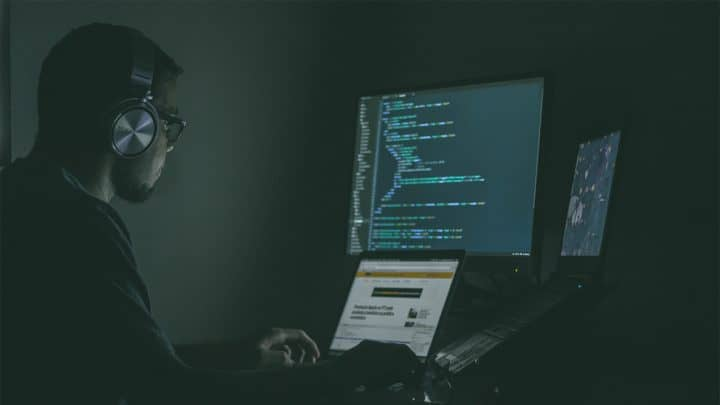 a man coding at night