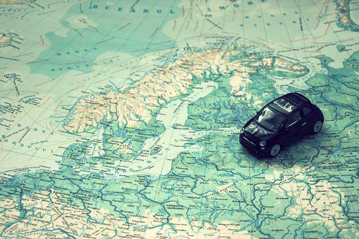 a toy car on top of world map