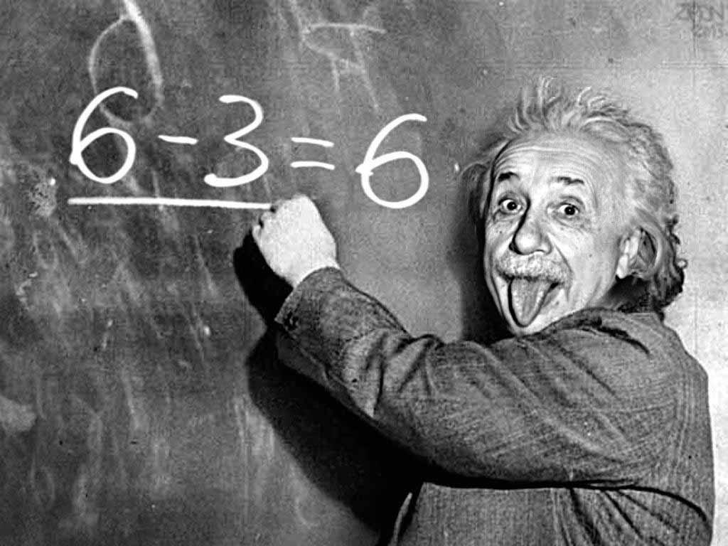 Albert Einstein writing 6-3 = 6