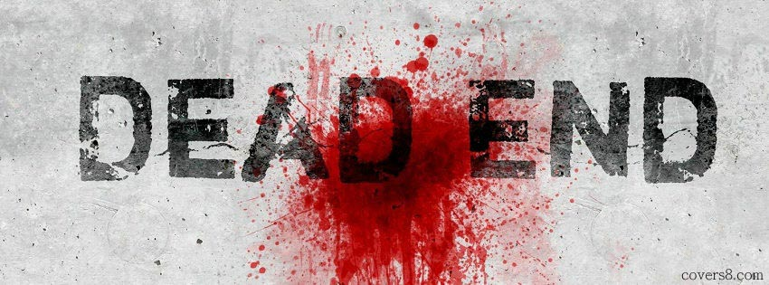 A wall with red paint splashed on it with overlay text of Dead End