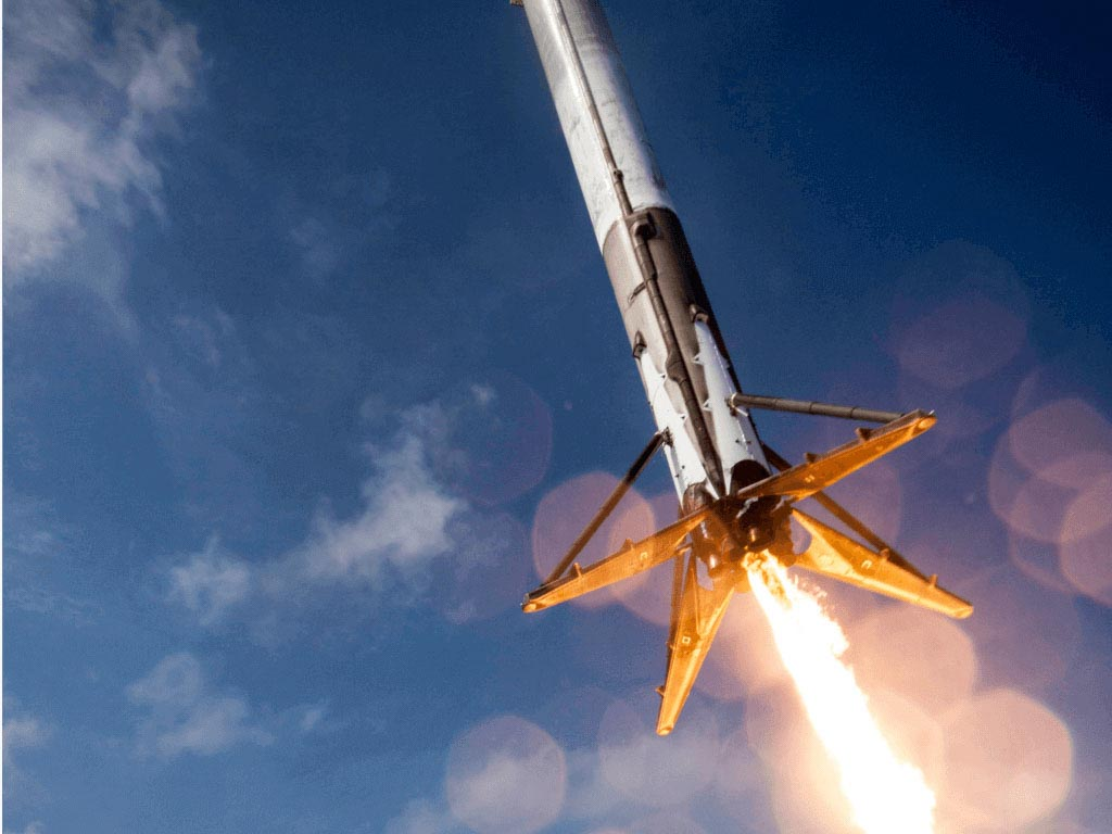 A rocket taking off to space