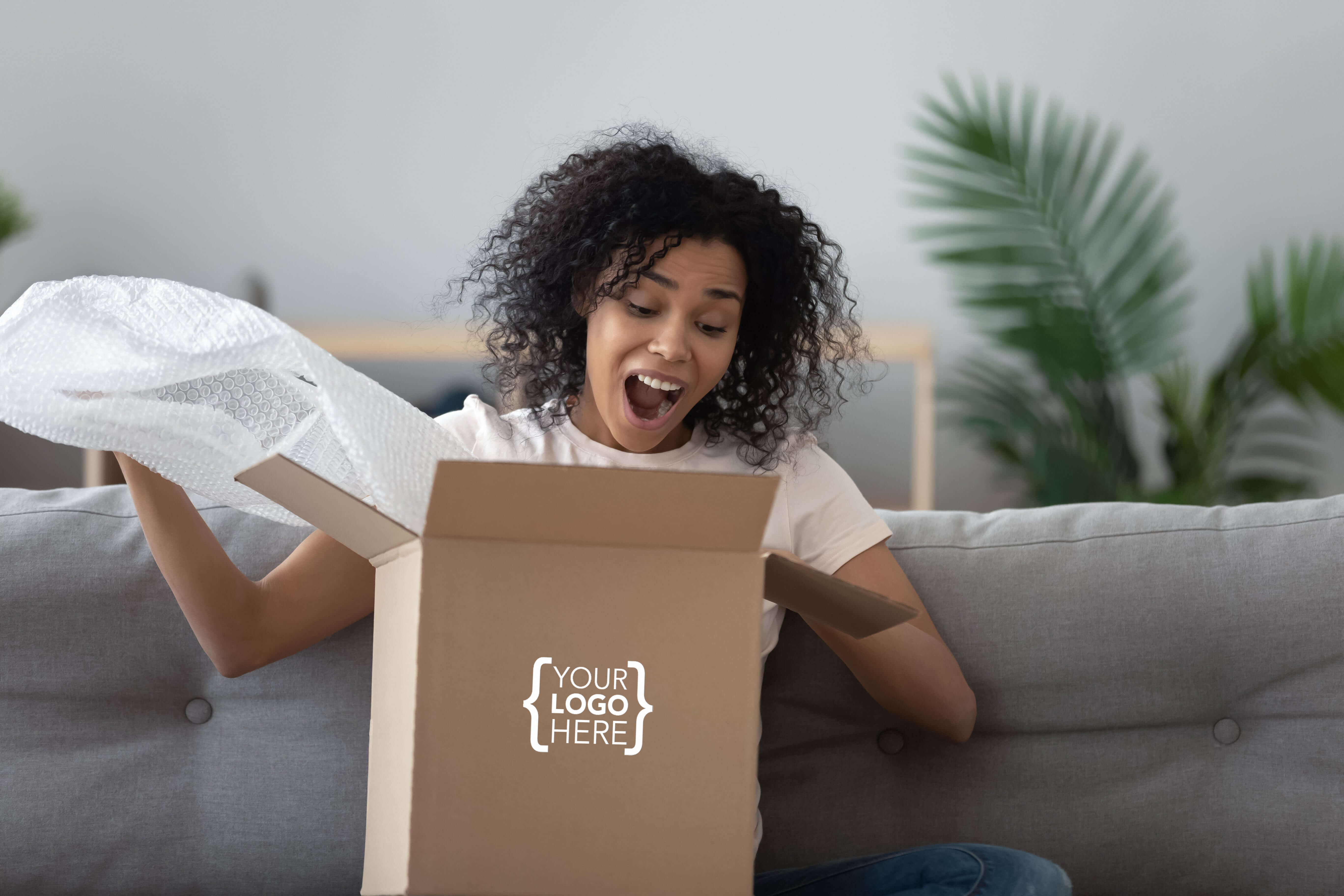Girl holding box with your logo