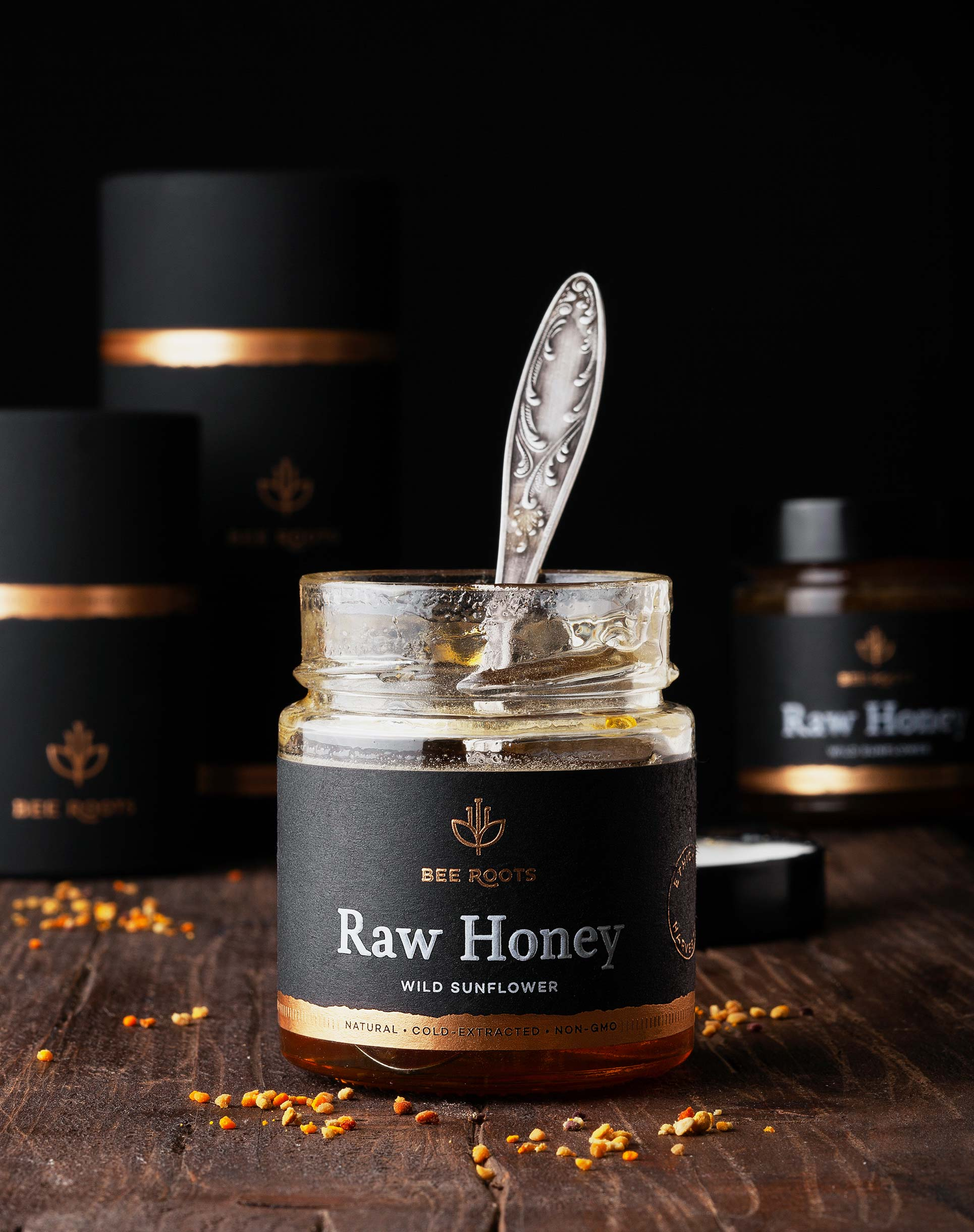 Front view of wild sunflower honey with spoon