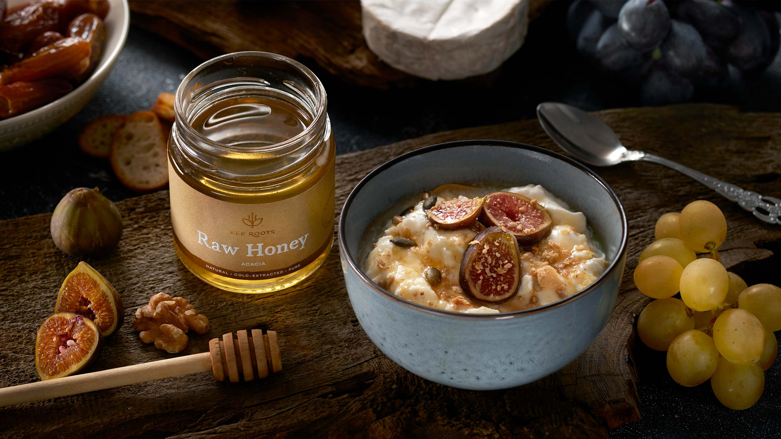 Acacia honey next to bowl of porridge