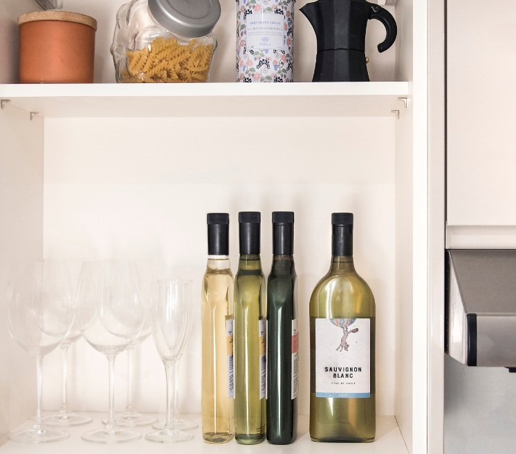 flat wine bottles on a shelf