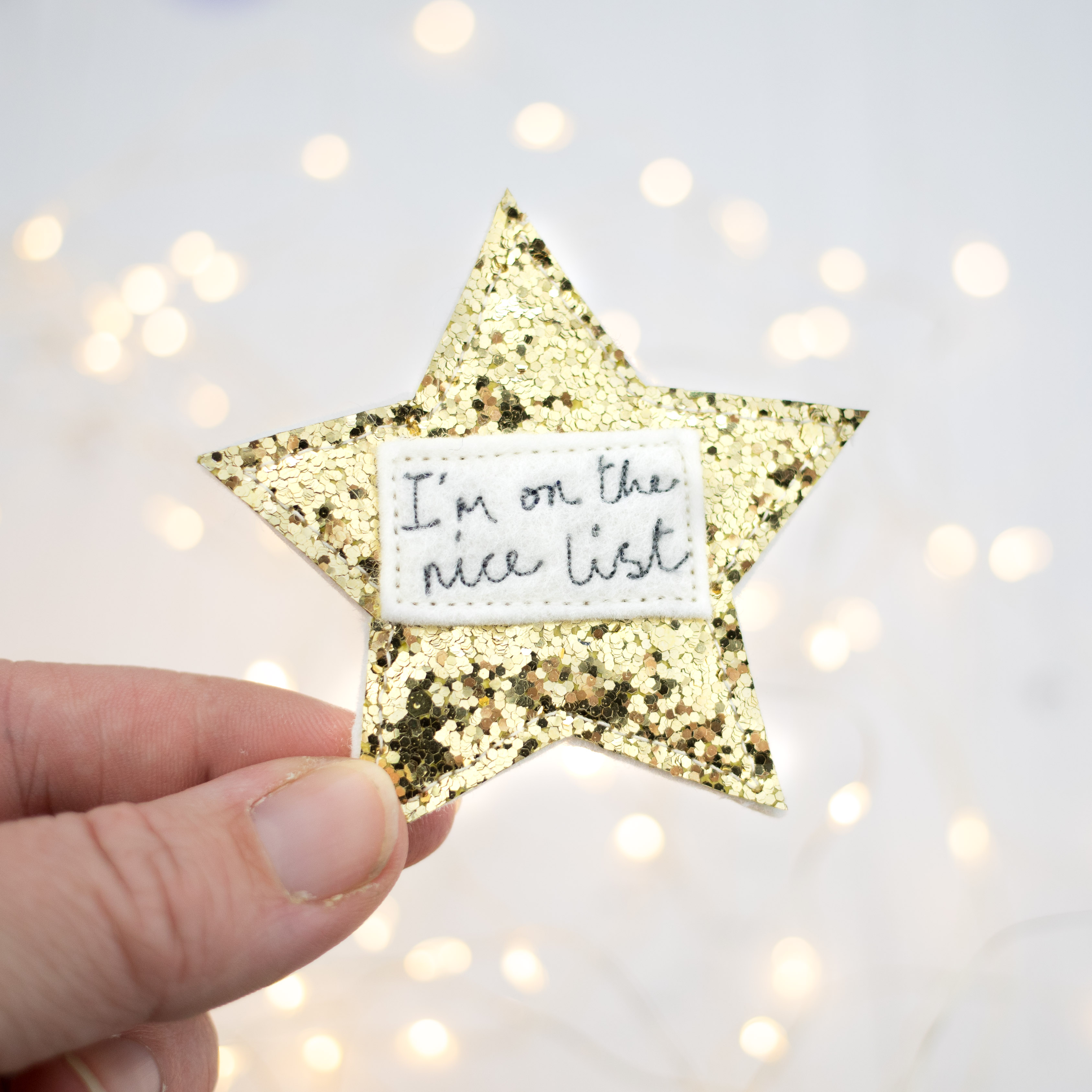 I'm on the nice list, sparkly badge.