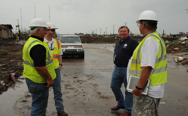FEMA Debris Deputy Task Force Leader speaks with US Corps of Engineers Debris Subject Matter Expert and debris contractors.