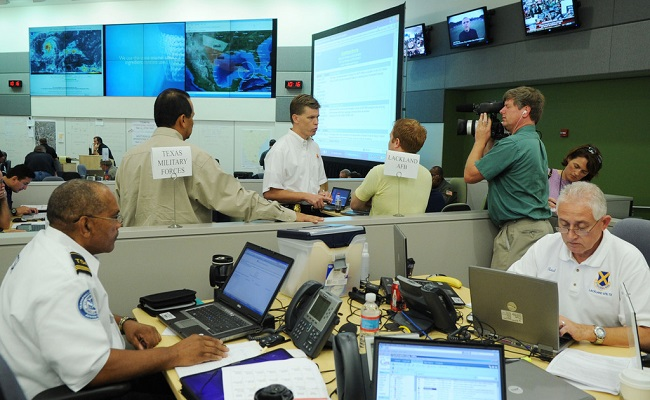 Local, state, federal and non-governmental agencies coordinating activities in their Emergency Operations Center.