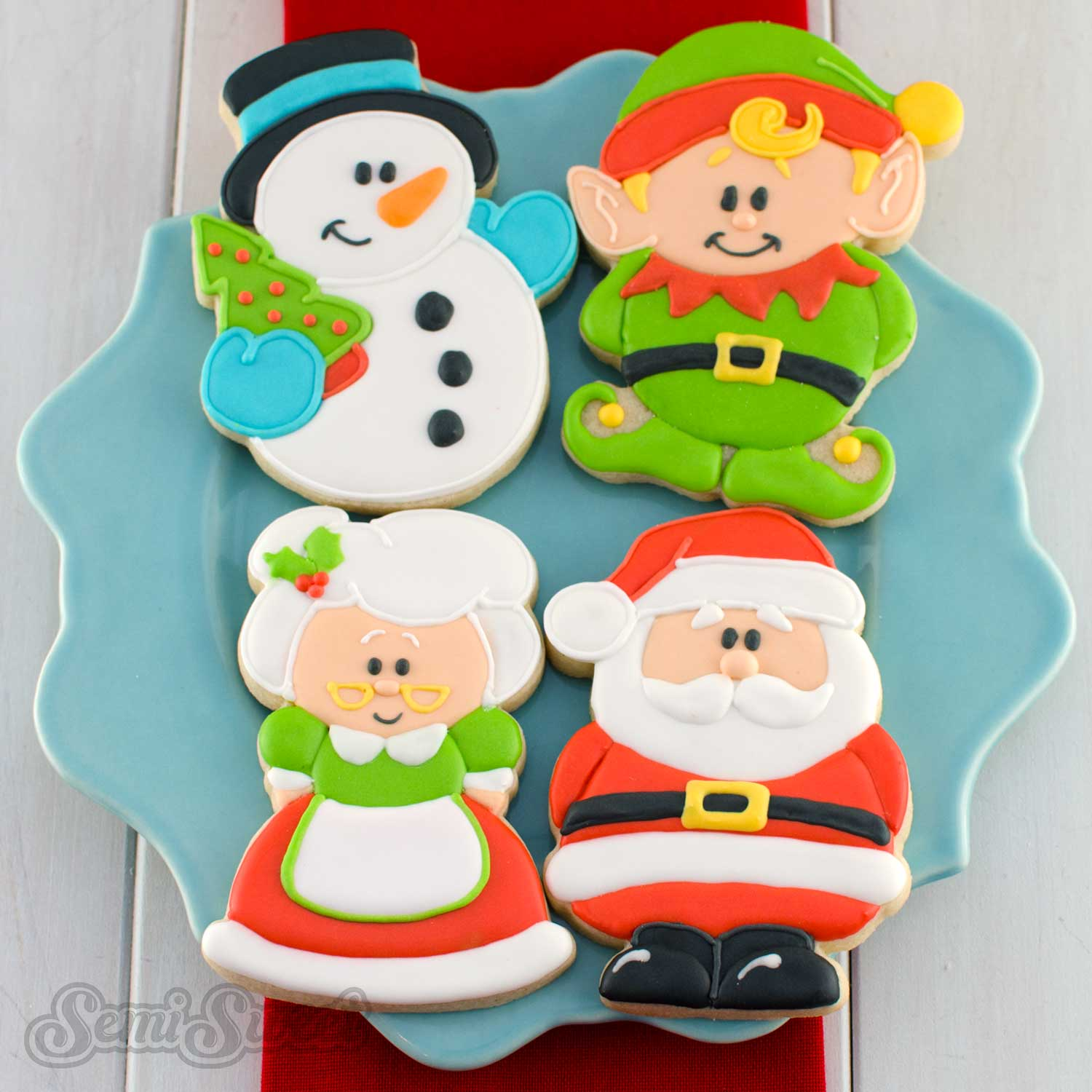 Christmas character cookies by Semi Sweet Designs