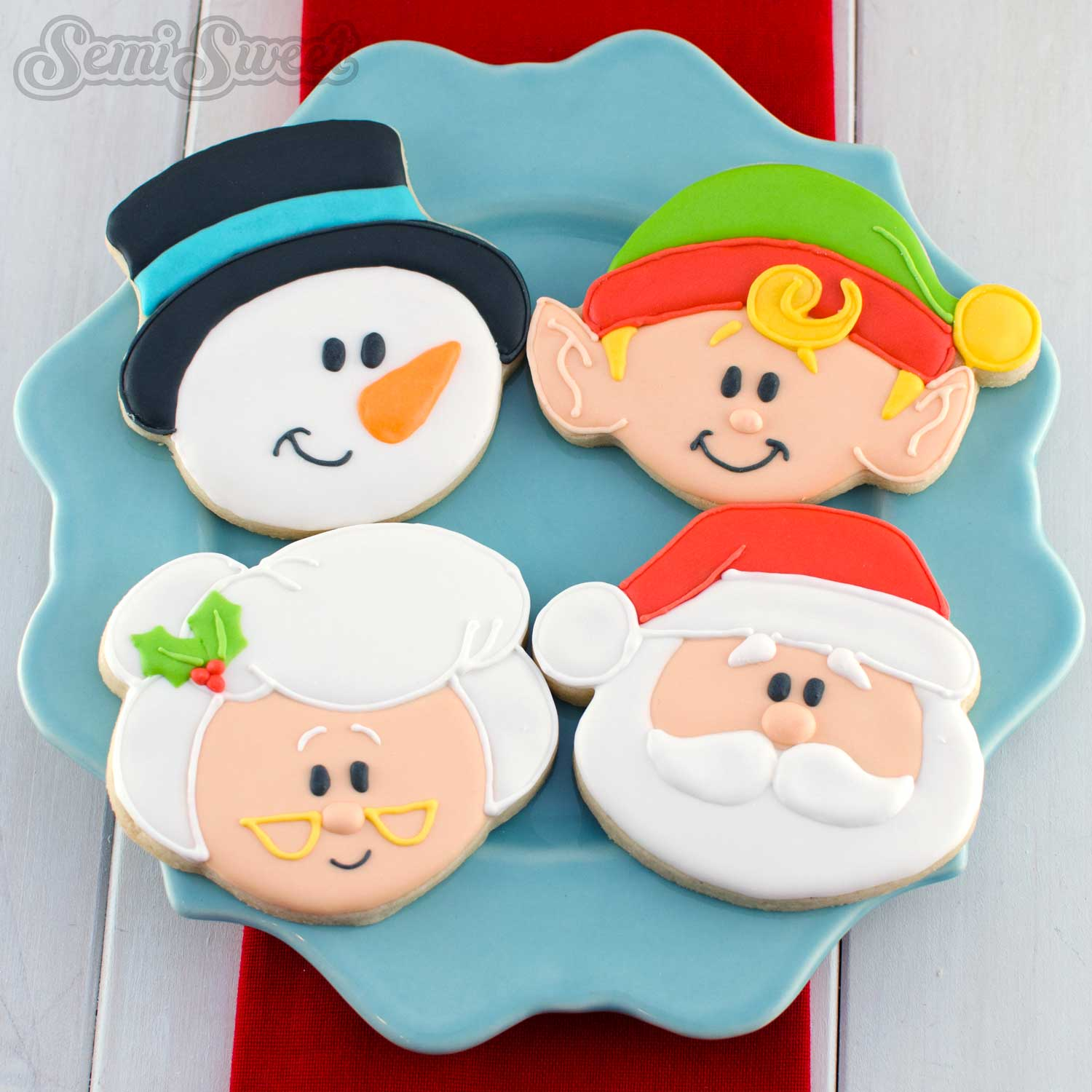 Christmas character head cookies by Semi Sweet Designs