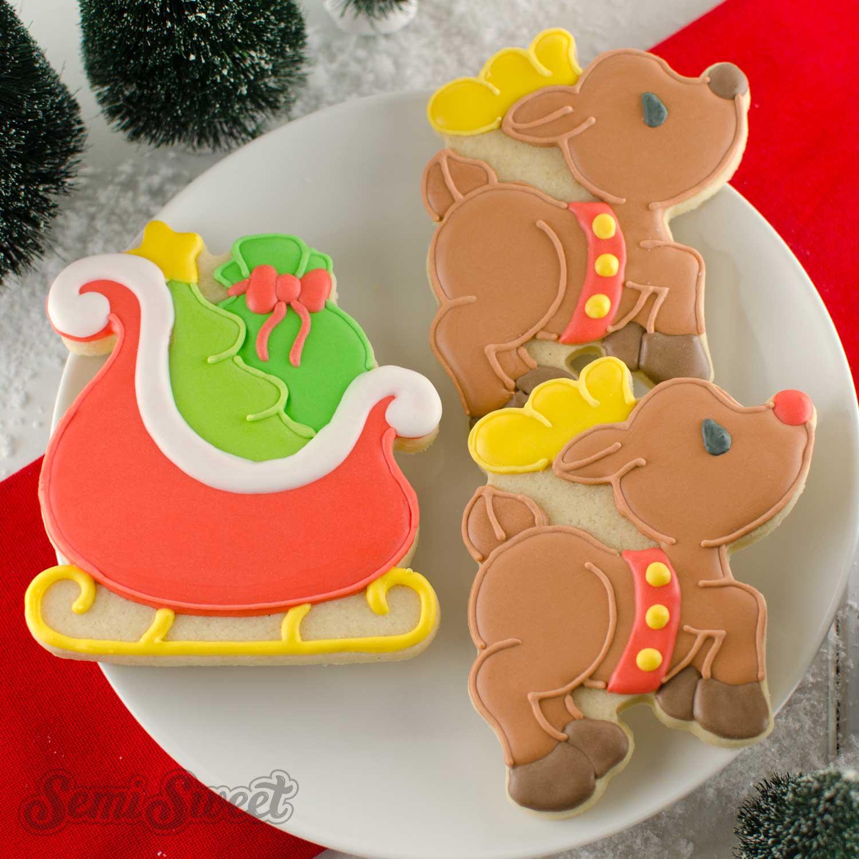 Santa sleigh and flying reindeer cookies by SemiSweetDesigns.com