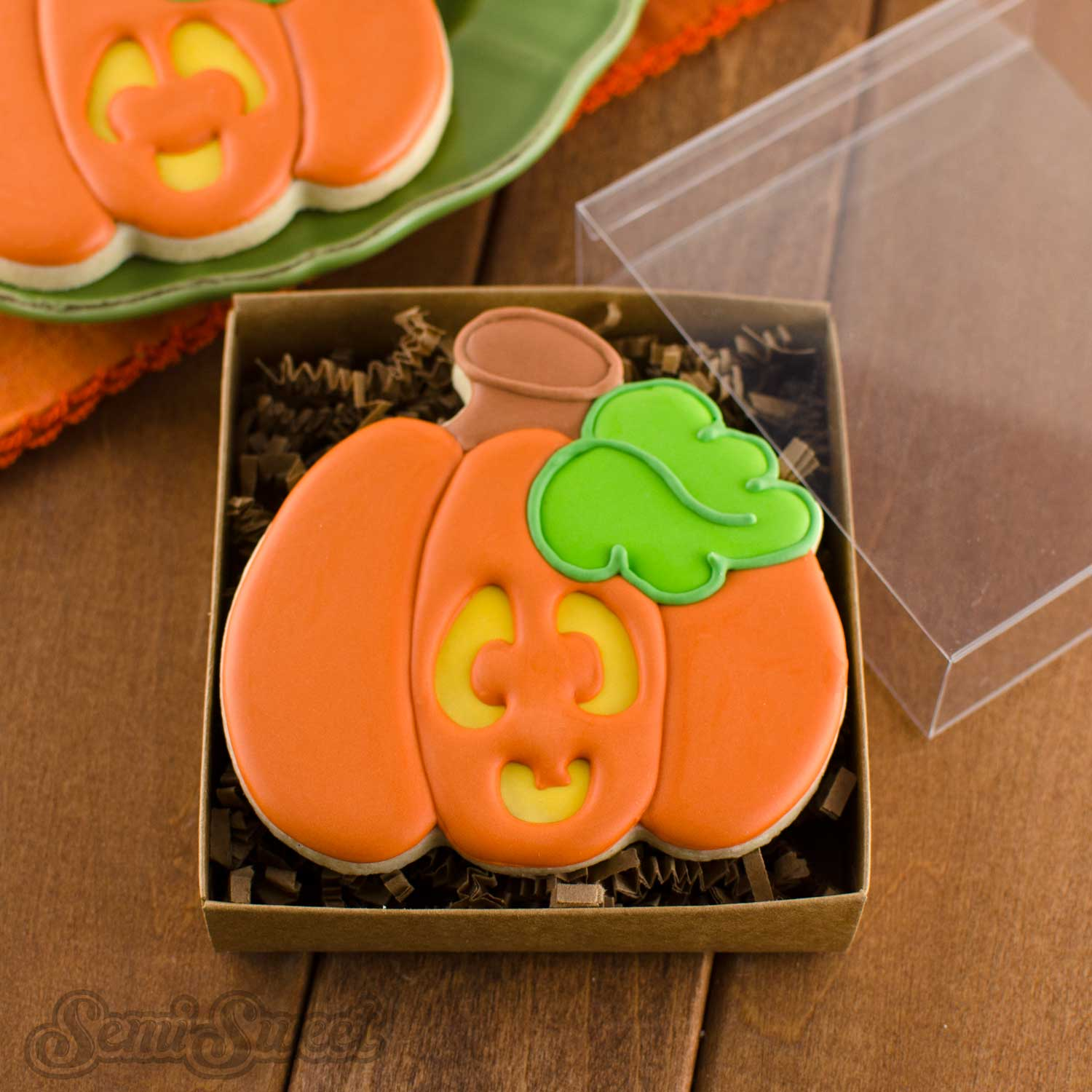 decorated pumpkin cookie in a box