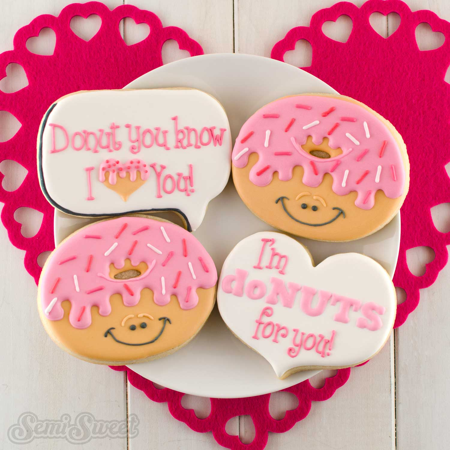 decorated donut cookies for Valentine's Day by Semi Sweet Designs