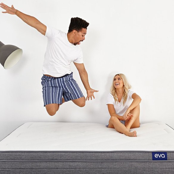 Couple bouncing on Eva mattress