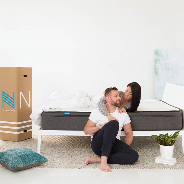 Couple unpacking Noa mattress