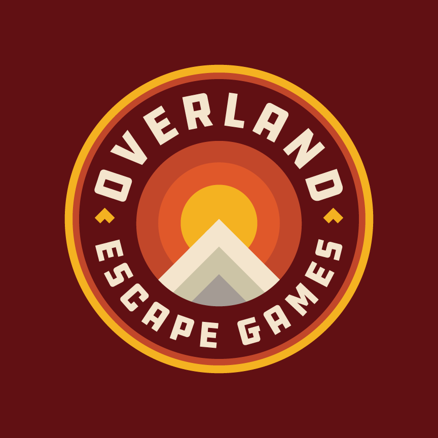 Overland Escape Games Logo Design and Branding. Circle crest/badge design with sun and mountains.
