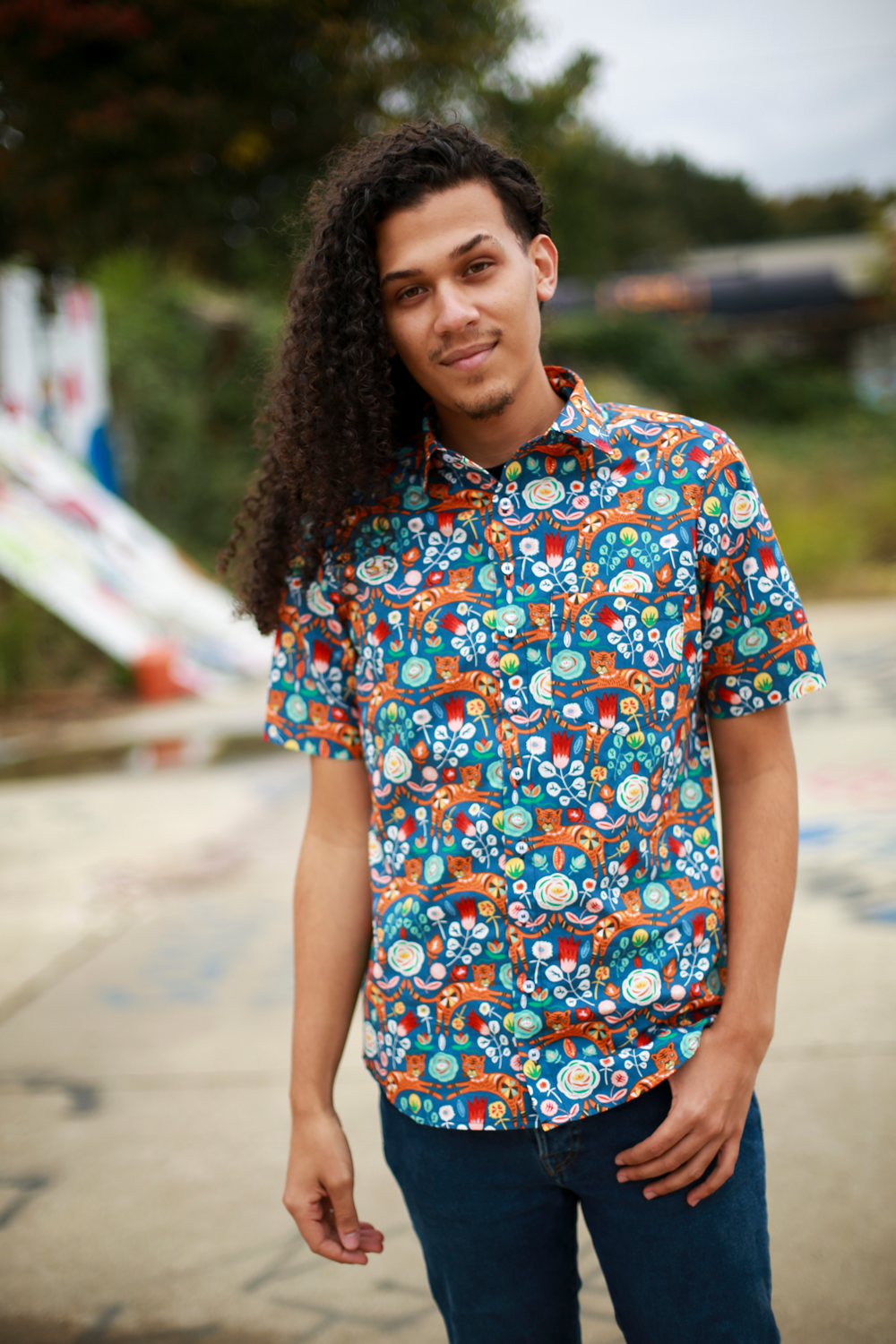 photograph of modeling a tiger print short sleeve button up