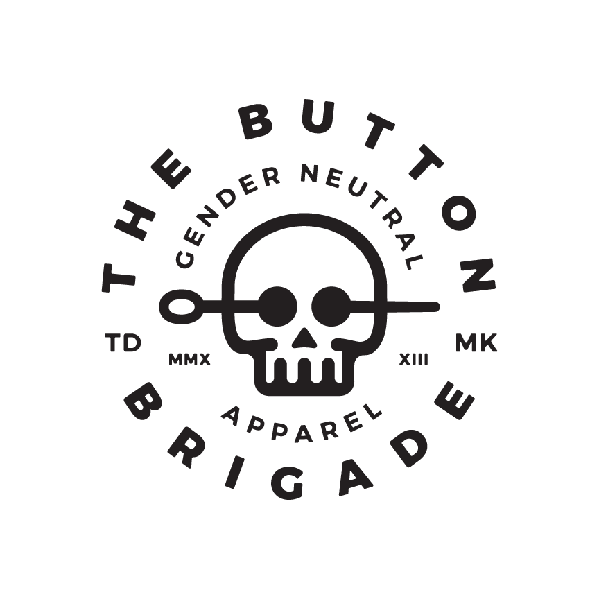 crest logo for the button brigade skull with sewing needle tagline gender neutral apparel