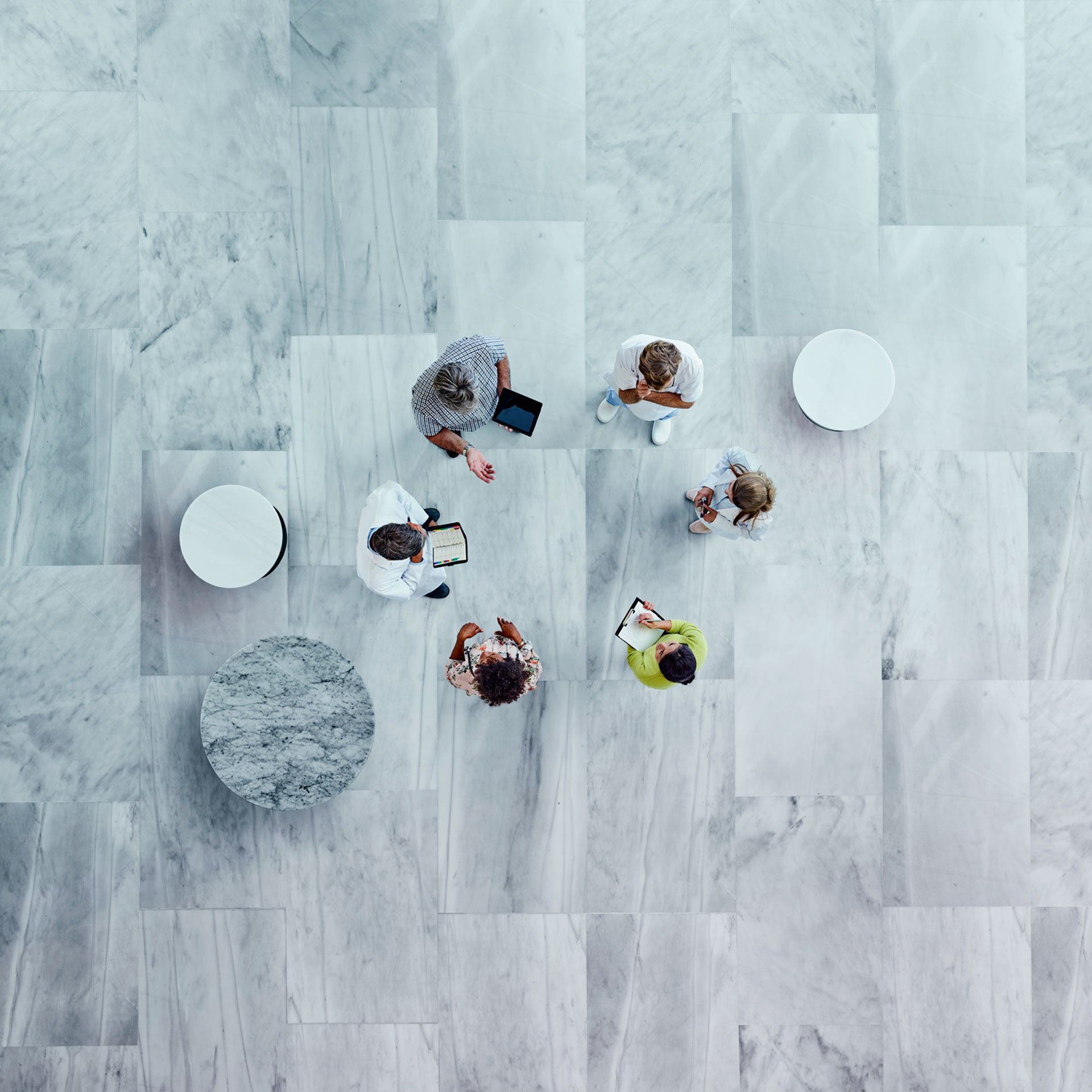 A top down view of people in a circle talking