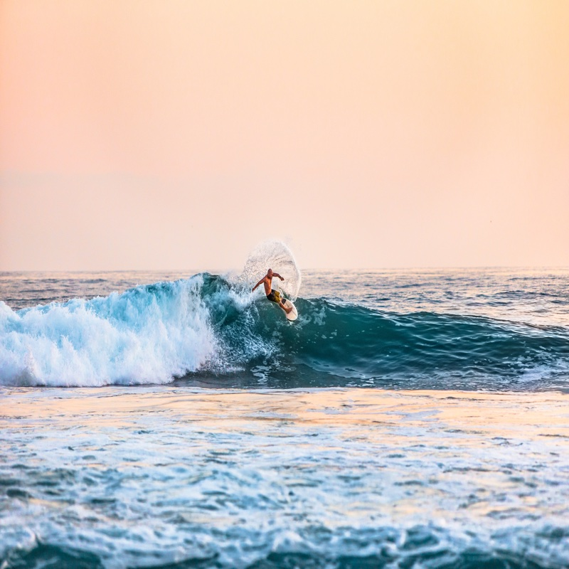 surfing at the san clemente pier