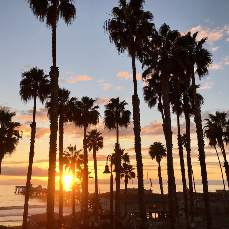 beautiful sunset view from oceanfront hacienda vacation rental at the San Clemente pier