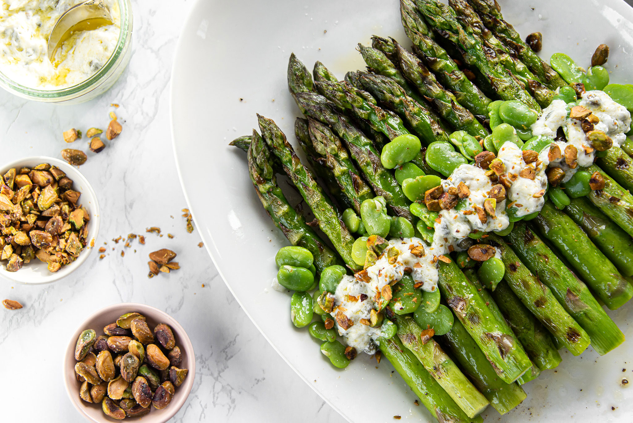 Asparagus With Caper Salsa, Fava Beans, and Toasted Pistachios