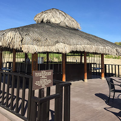 Picture of beach bar with swings for bar stools