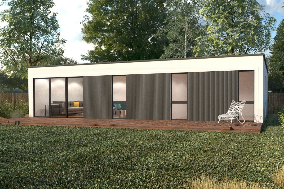 A black and white modular home with its own deck, on which a chair is set up, surrounded by grass and trees.
