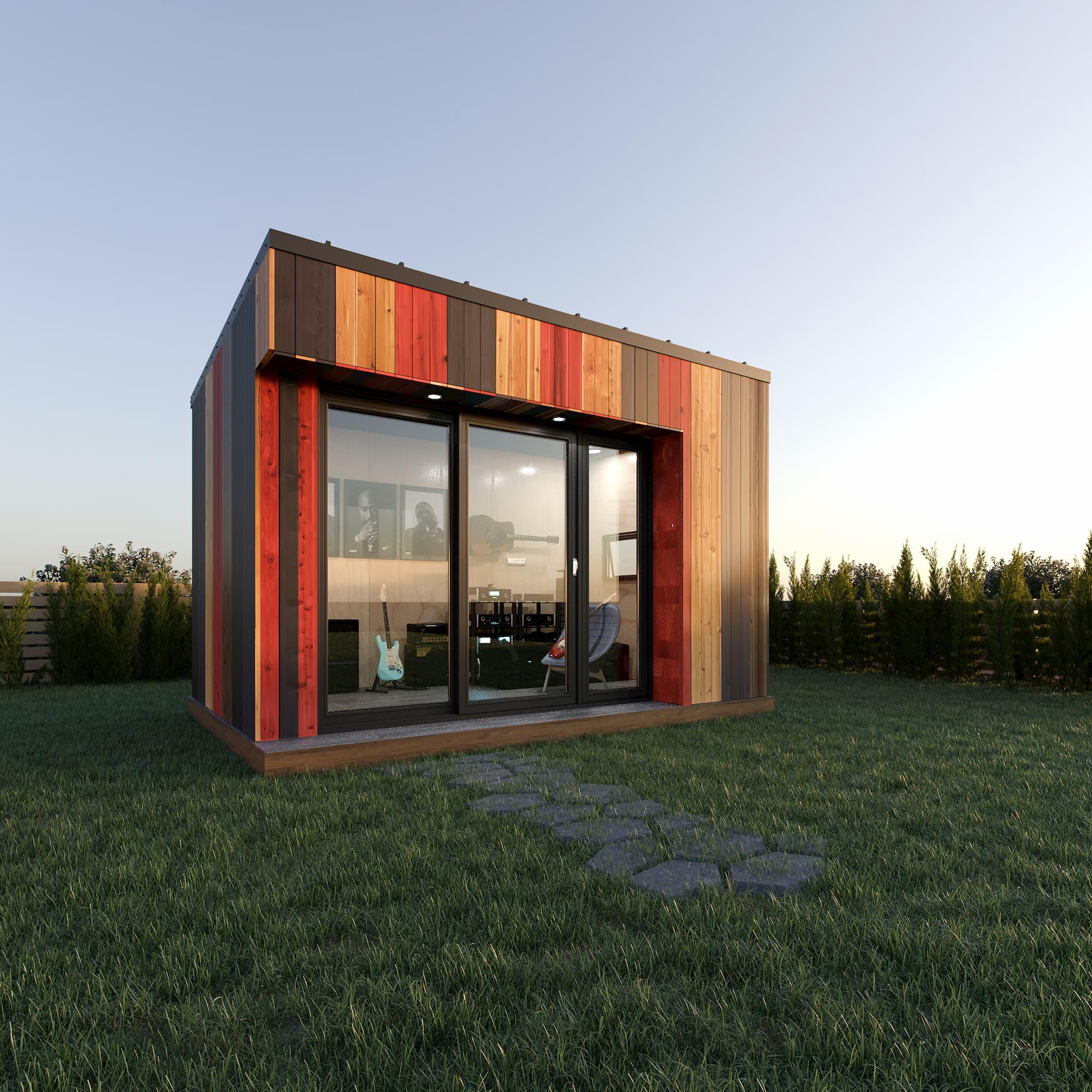 A small modular office situated in a backyard, with wooden panelling, a large window, and a desk & sofa visible.