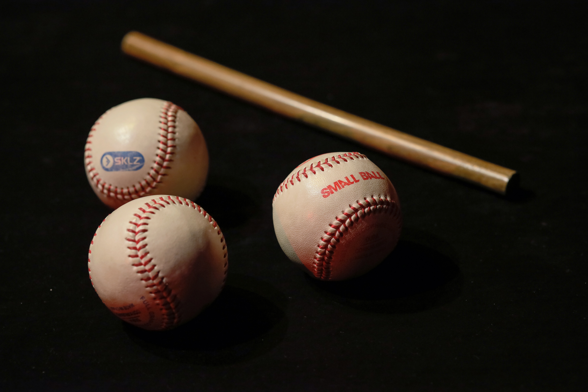 Cups and (base) balls, a classic magical illusion at the Red Spade Theater