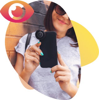 Woman smiling and holding a phone with camera surrounded with colorful gradient shapes