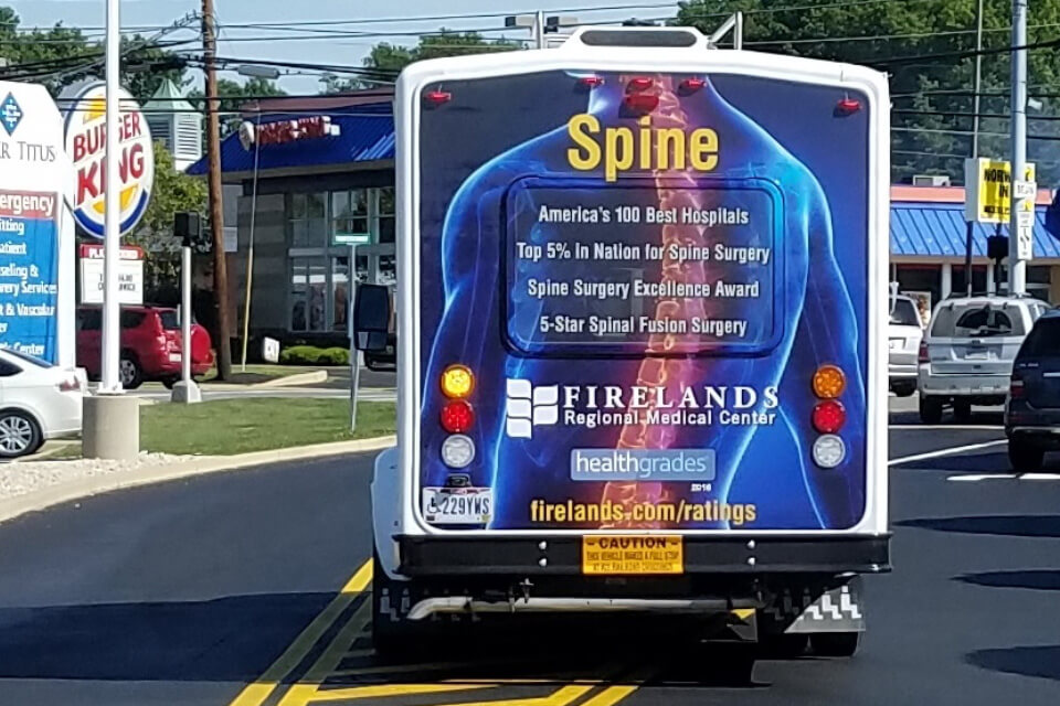transit advertising with paratransit tail wraps on vehicles