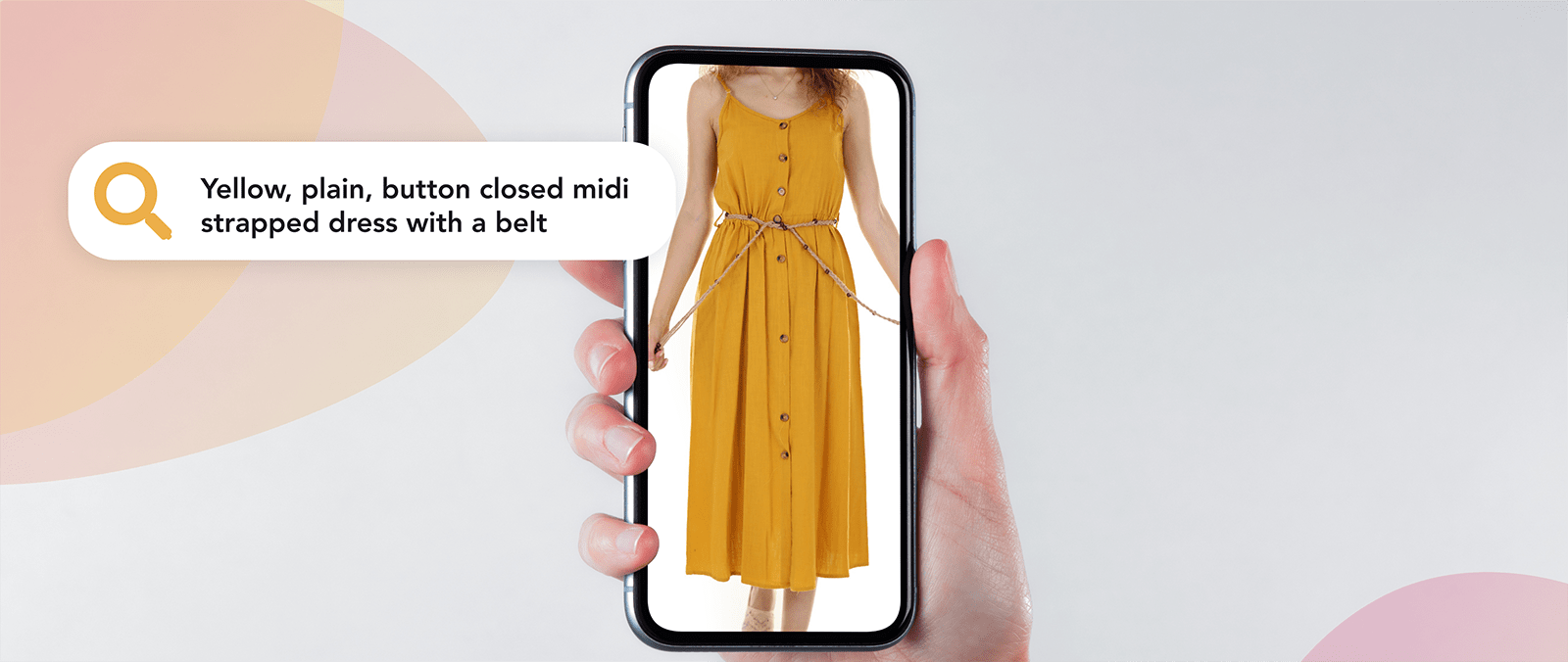 A woman holding a phone looking at a yellow plain dress