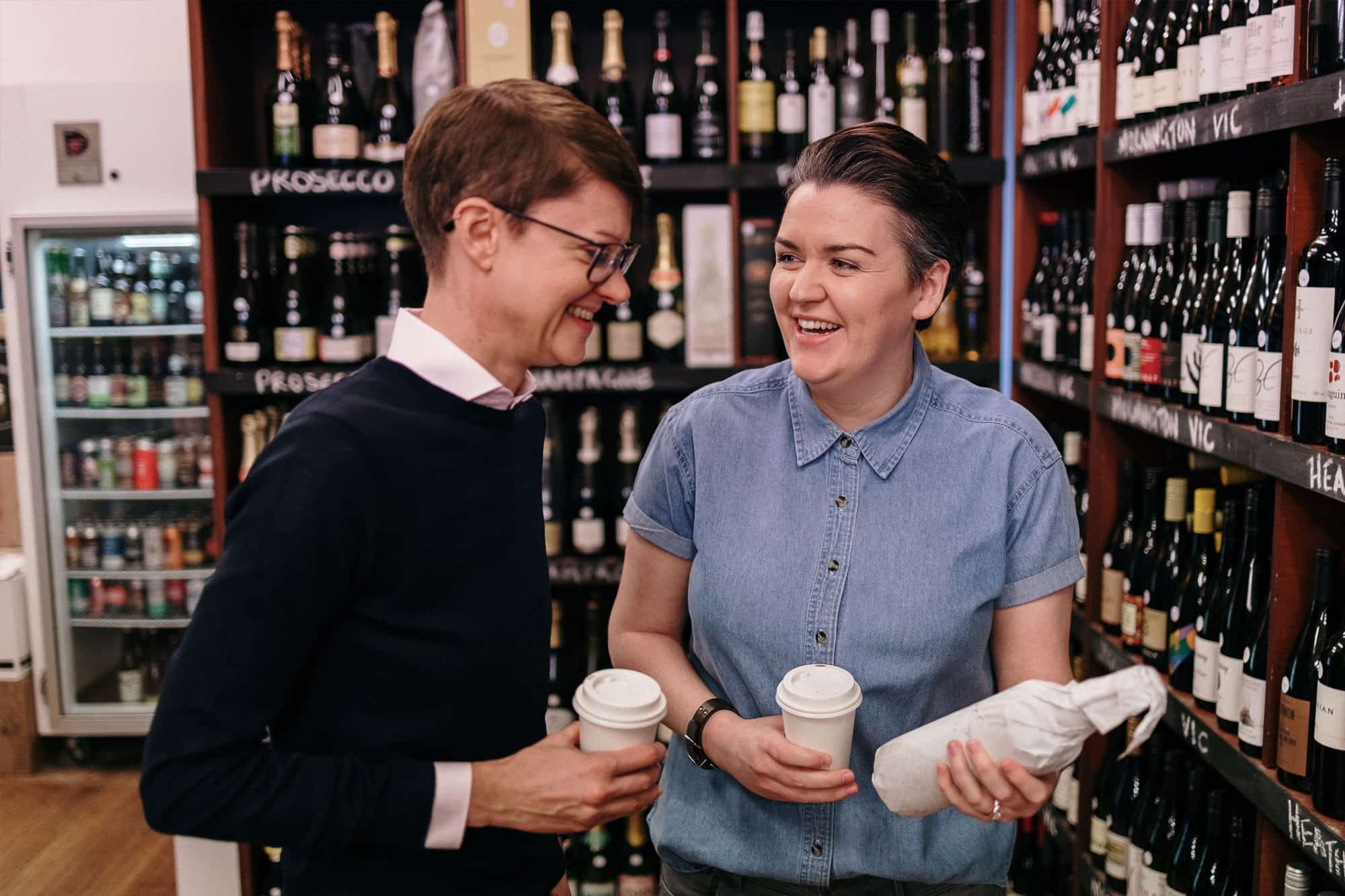 Couple browsing wine store