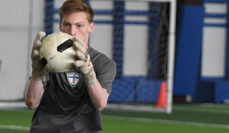 Goalkeeper in training, focused and alert