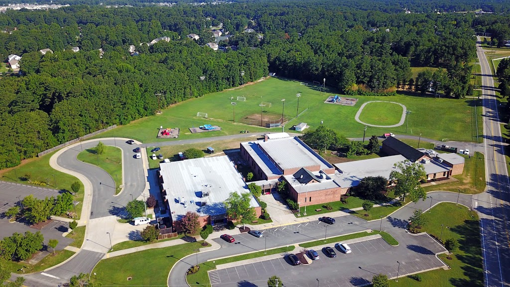 Birdseye view of Washington & Henry Elementary school with large green field in the background; where we train.