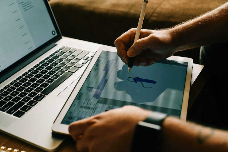 A man drawing on a tablet