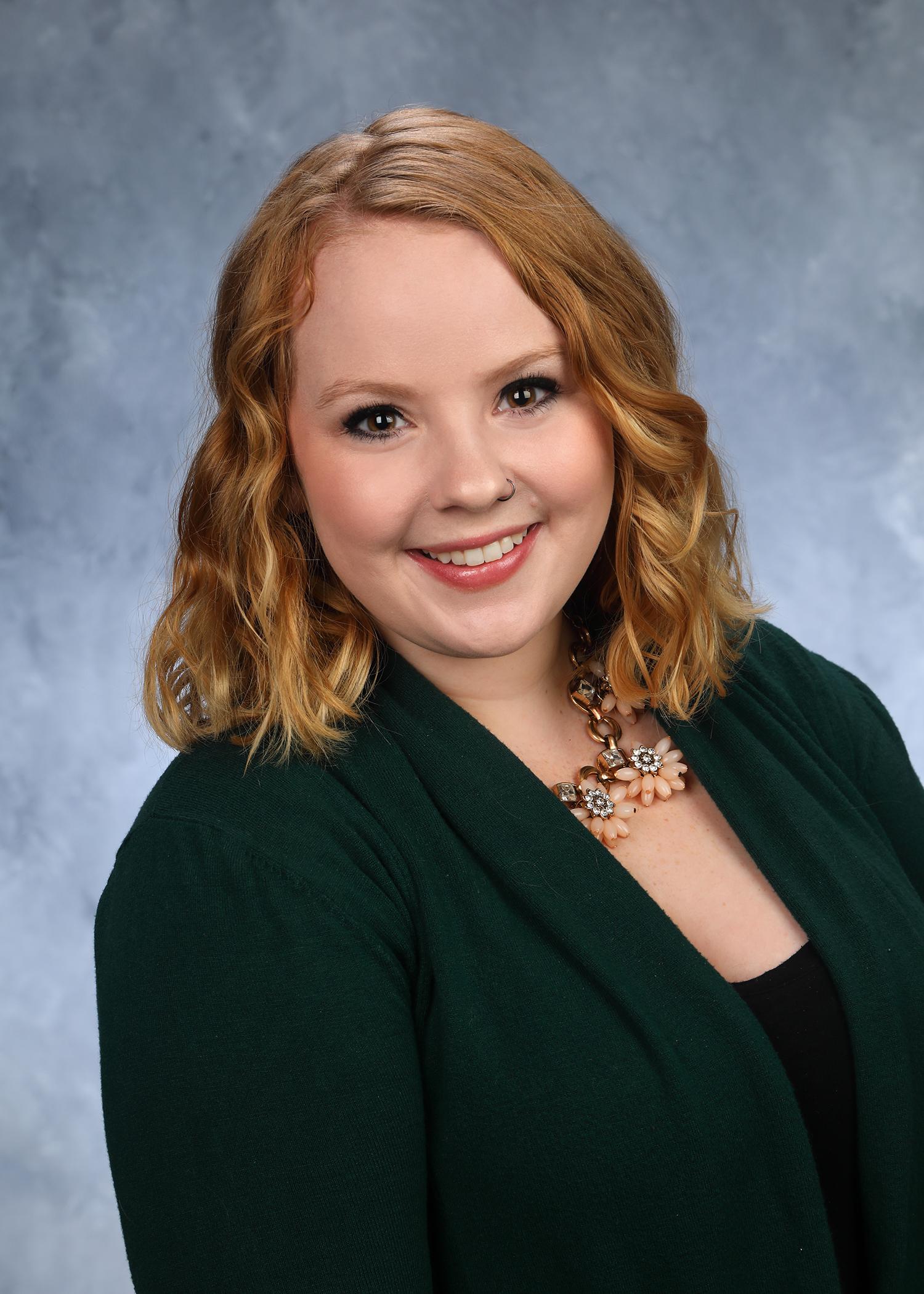 Headshot of Carly Tate, Vice President of Marketing and Development