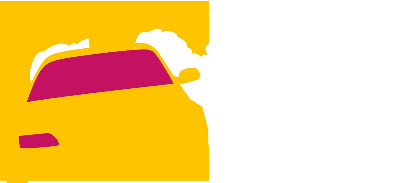 Yellow self-driving race car drifting around corner with smoke trail
