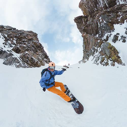 Luca Li snowboarding down Surprise Pass