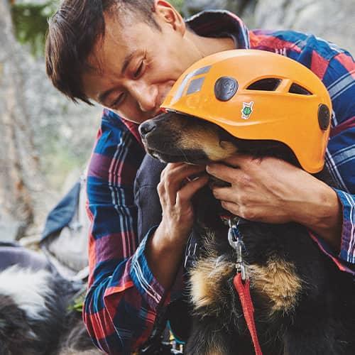 Luca Li putting climbing helmet on Baloo