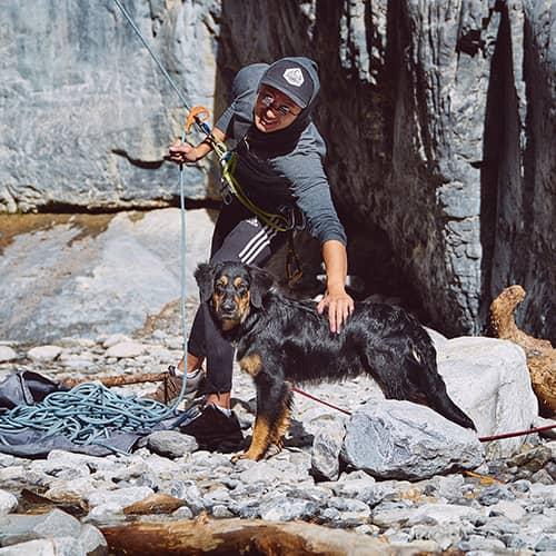 Luca Li belaying with Baloo in Grotto Canyon