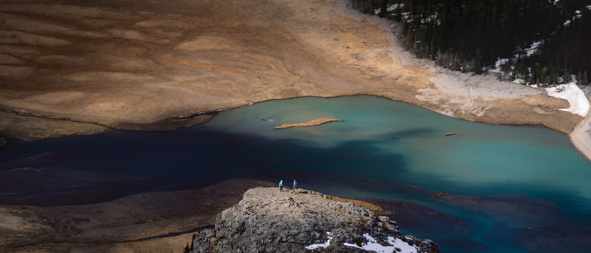 Landscape Photography Panorama of two hikers standing in a light pool on Baldy peak trail with barrier lake kananaskis by Luca Li