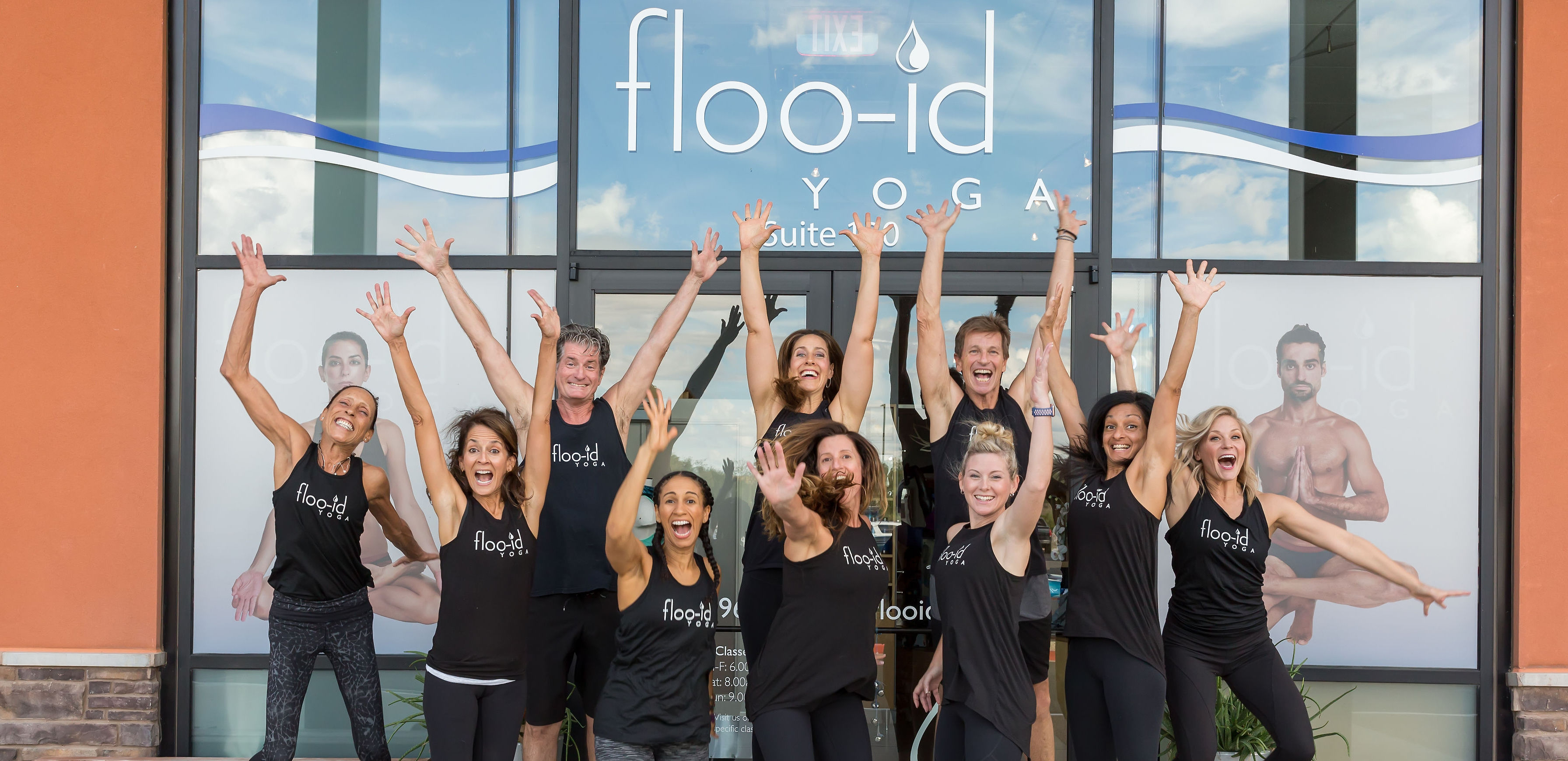 Happy floo-id YOGA instructors jumping to welcome you!